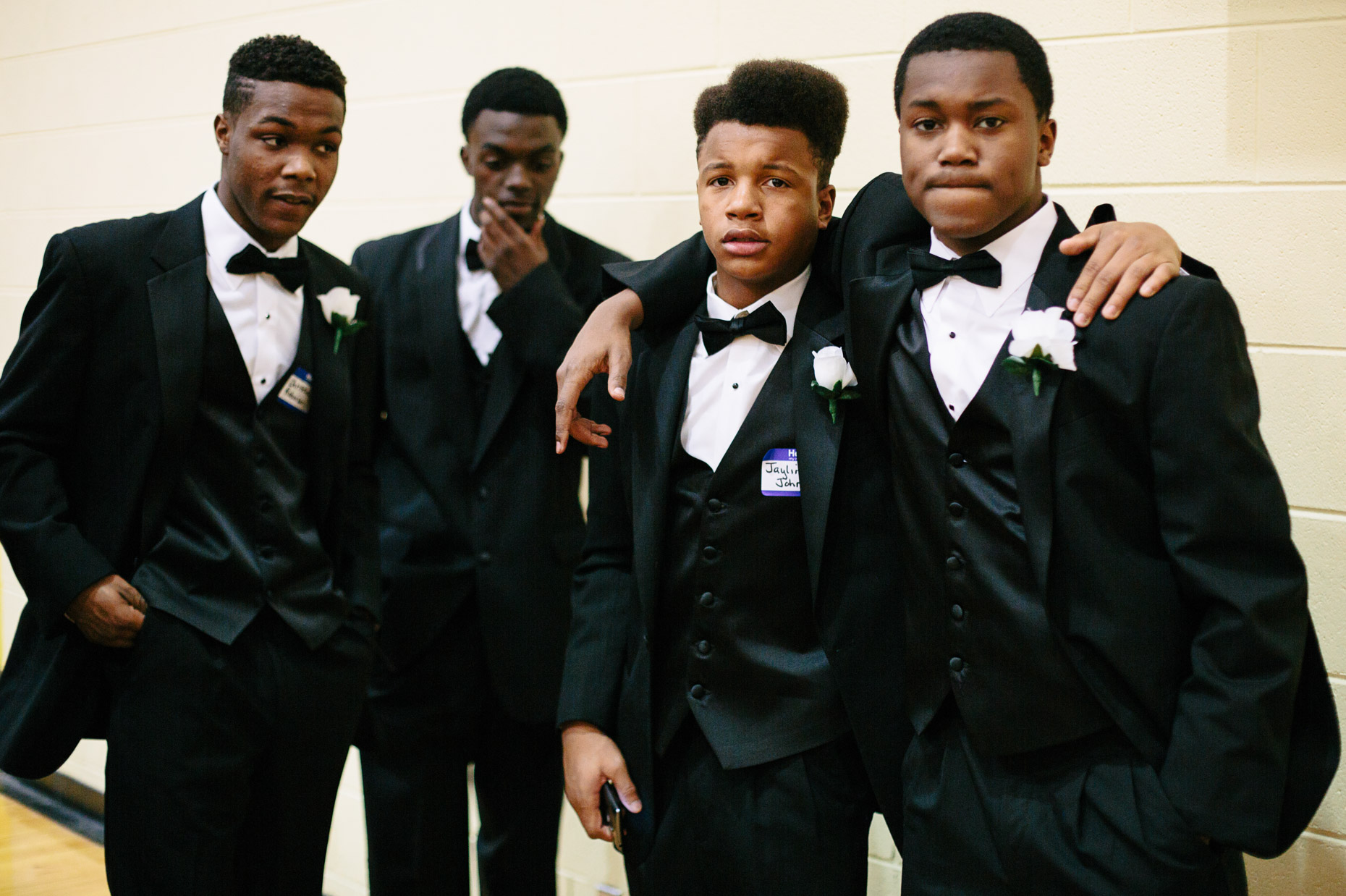 A boy gather in the gymnasium of the Northcott Neighborhood House during the 500 Black Tuxedos Event, organized by Andre Lee Ellis, on Saturday December 12th, 2015 in Milwaukee, Wisconsin.