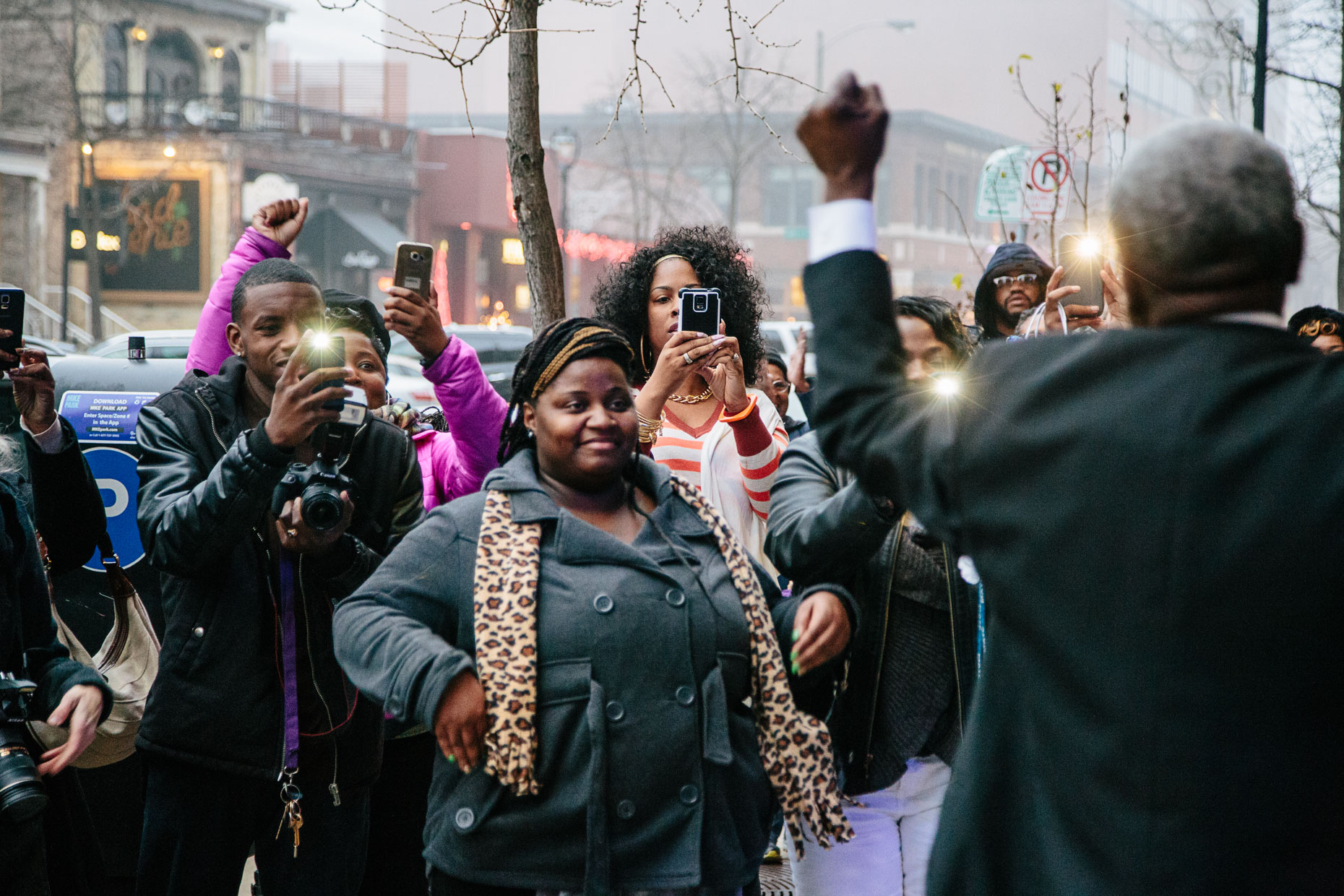 Andre Lee Ellis, the organizer of the 500 Black Tuxedos Event, speaks to supporters outside of the Chic Cafe on Jefferson Street, Saturday December 12th, 2015 in Milwaukee, Wisconsin.
