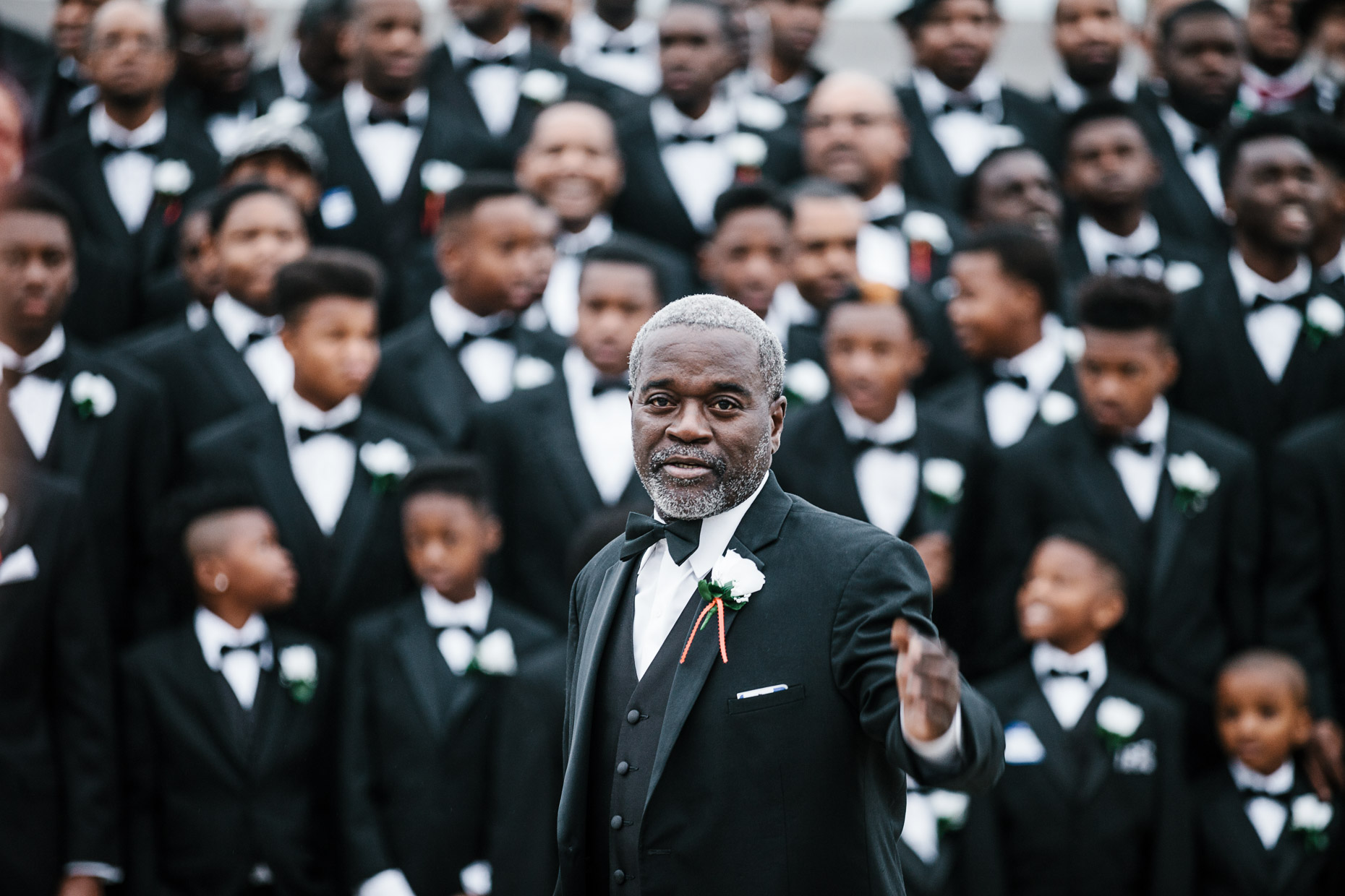 Participants of the 500 Black Tuxedos Event, organized by Andre Lee Ellis, gather for a group photo on the steps of the Milwaukee Art Museum on Saturday December 12th, 2015 in Milwaukee, Wisconsin.