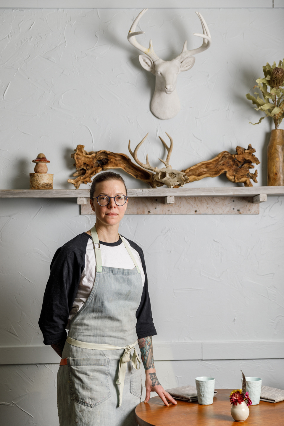 Iliana Regan, Michelin-starred chef of the restaurant Elizabeth in Chicago, stands next to a table in her restaurant before dinner service on November 22nd, 2019.
